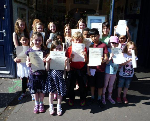 Happy faces outside the Arison gallery - no one went home without a certificate!