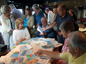 Passengers sharing their paintings.